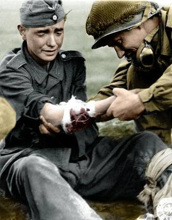 a-young-german-wwii-soldier-in-pain-being-treated-by-an-american-gi