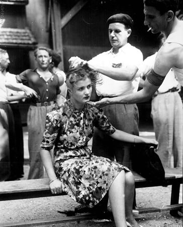 french-civilians-shave-the-head-of-a-woman-accused-of-collaborating-with-the-germans-1944